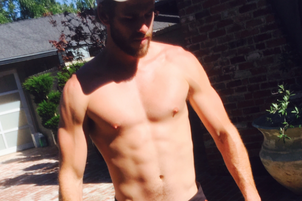 "Please Enjoy These Photos of Liam Hemsworth Wearing Revealing ""Tiny Shorts"""
